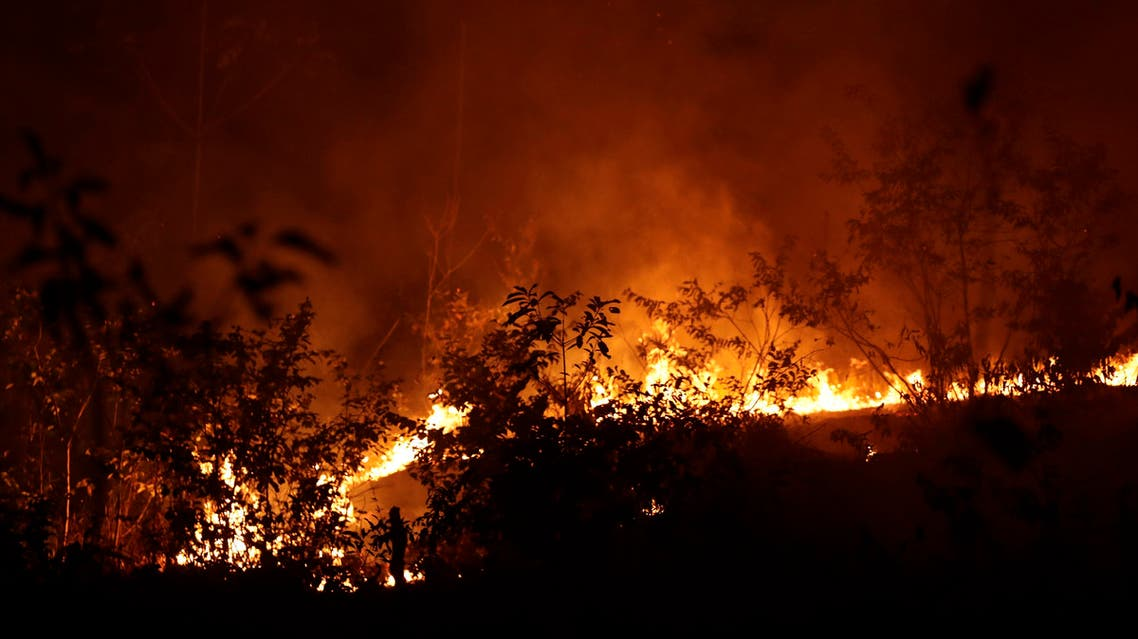 A fire burns in highway margins in the city of Porto Velho, Rondonia state, part of Brazil's Amazon, Sunday, Aug. 25, 2019. (AP)