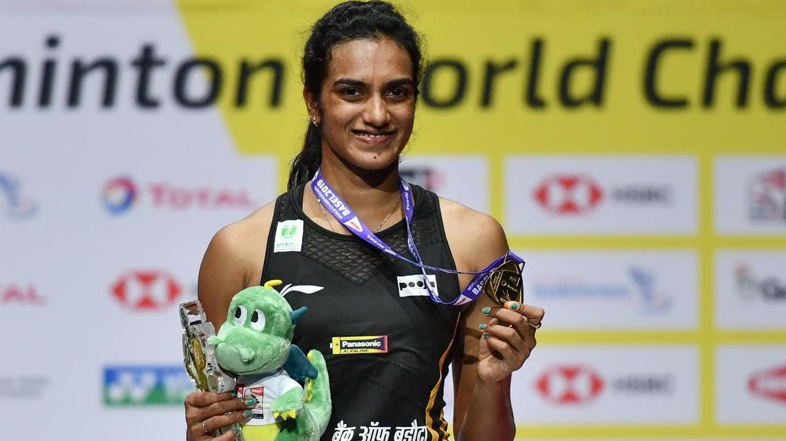 Pusarla Venkata Sindhu poses on with the gold medal after her victory over Nozomi Okuhara during their women's singles final match at the BWF Badminton World Championships in Basel on August 25, 2019. (AFP)
