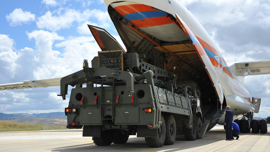 A handout photograph taken and released on July 12, 2019, by the Turkish Defence Ministry shows a Russian military cargo plane, carrying S-400 missile defence system from Russia, during its unloading at the Murted military airbase (also known as Akincilar millitary airbase), in Ankara. The delivery to an air base in Ankara comes after Washington warned this week that there would be real and negative consequences if Turkey bought the defence system. NATO, which counts Turkey as one of its members, has repeatedly warned Turkey that the Russian system is incompatible with other NATO weapons systems, not least the F-35, a new generation multi-role stealth fighter jet.
