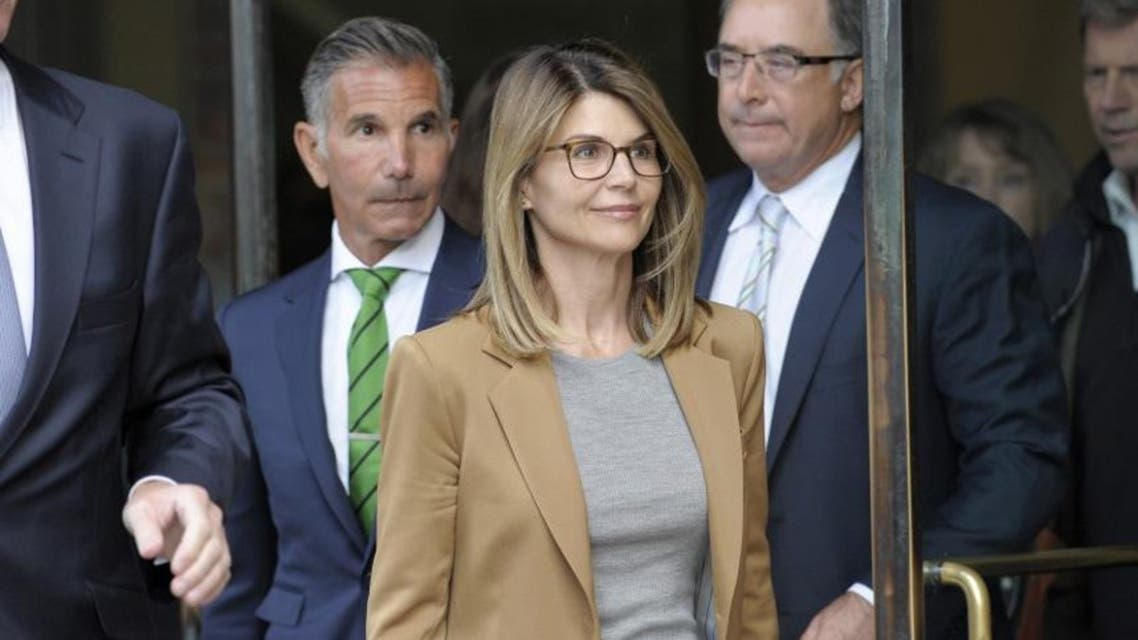 Lori Loughlin exits the courthouse after facing charges for allegedly conspiring to commit mail fraud and other charges in the college admissions scandal at the John Joseph Moakley United States Courthouse in Boston on April 3, 2019. (AFP)