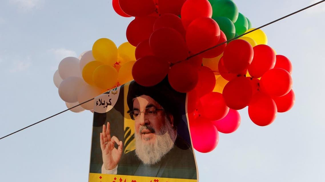 Balloons with a picture of Lebanon's Hezbollah leader Sayyed Hassan Nasrallah hang in the air during a rally. (Reuters)