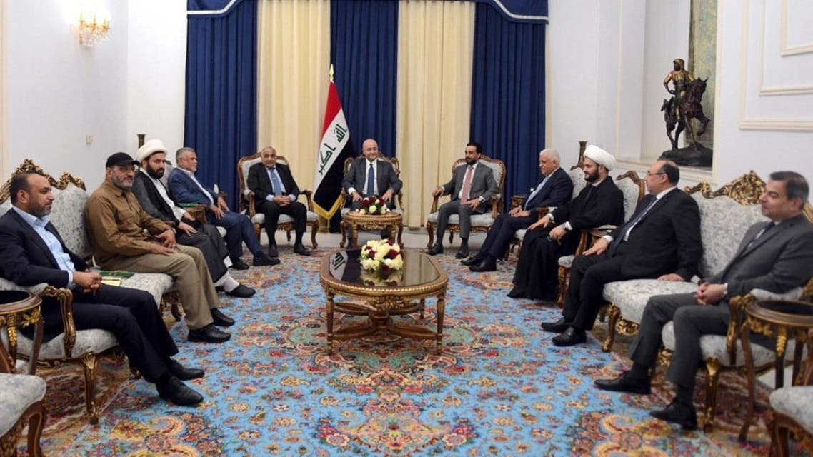 This handout photograph released by the Iraqi President's Office on August 26, 2019, shows (L to R) MP and spokesman for Hashed al-Shaabi. (AFP)