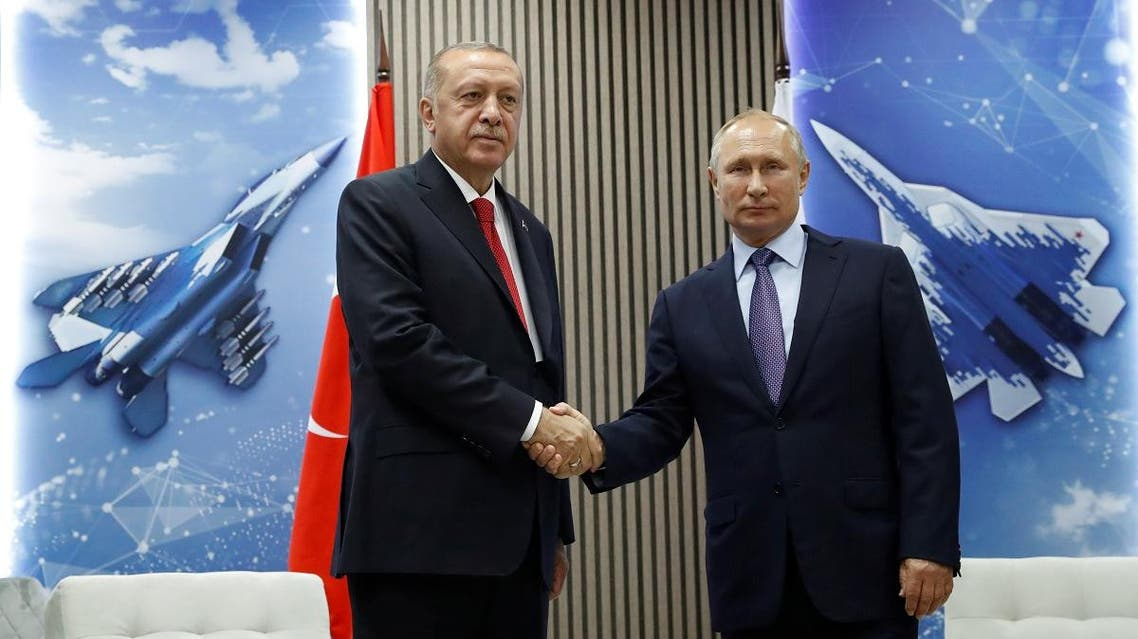 Russian President Vladimir Putin and Turkish President Recep Tayyip Erdogan shake hands during their meeting on the sidelines of the MAKS-2019 International Aviation and Space Salon in Zhukovsky outside Moscow. (Reuters)
