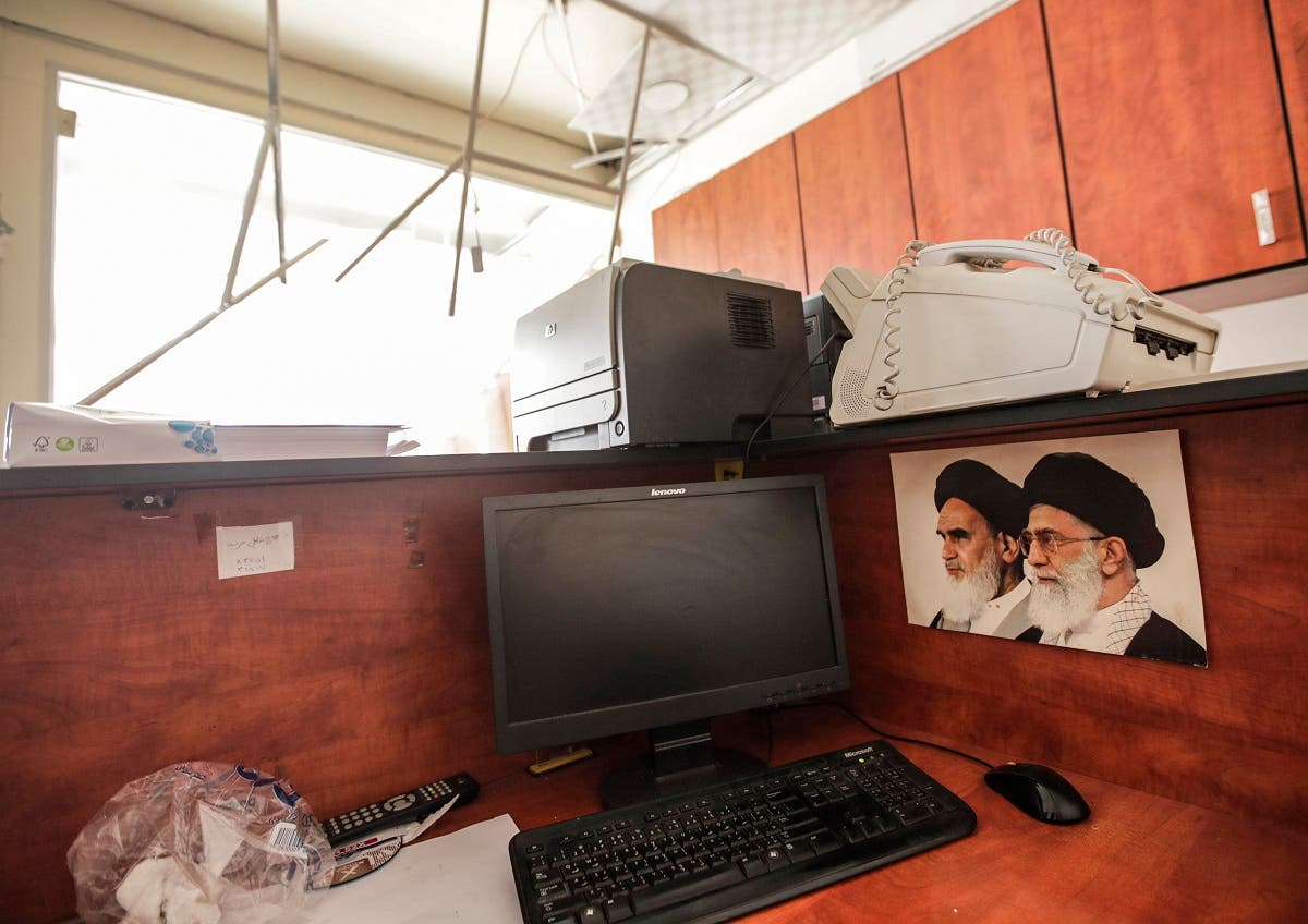 Damage inside a media center of the Lebanese Hezbollah in the south of the capital Beirut, after two drones came down in the vicinity of its building. (AFP)