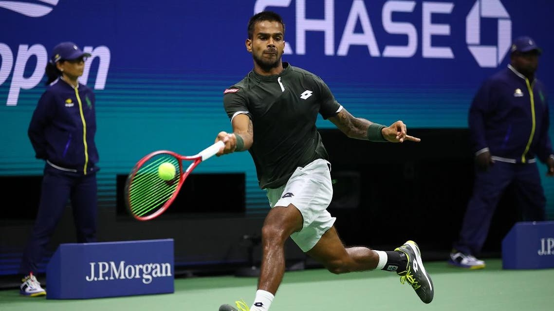 Sumit Nagal of India returns a shot against Roger Federer of Switzerland during their Men's Singles first round match on day one of the 2019 US Open. (AFP)