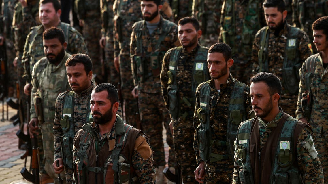Syrian Kurdish members of the People's Protection Units (YPG) attend the funeral of a slain Kurdish commander in the northeastern city of Qamishli on December 6, 2018.