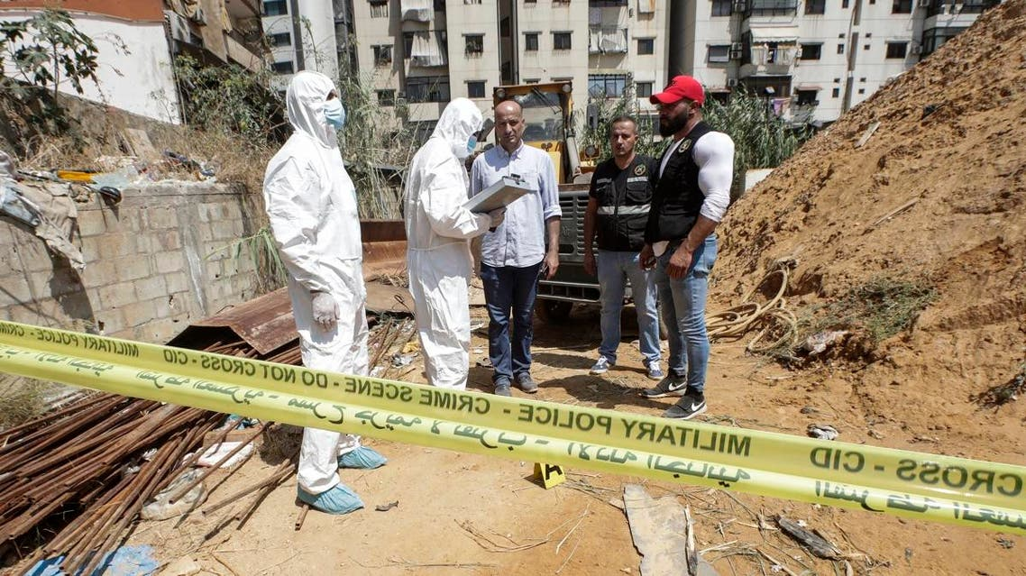 Forensic investigators of Lebanon's military intelligence inspecting the scene where two drones came down in the vicinity of a media center for Hezbollah south of Beirut. (AFP)