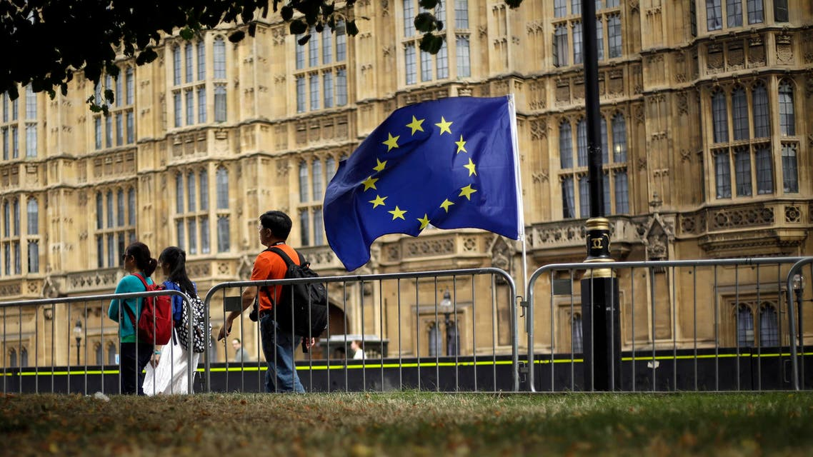 An EU flag is seen near the Houses of Parliament in central London, Wednesday, Aug. 28, 2019. (AP)