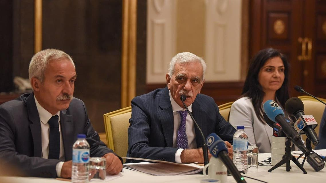 The removed mayor of Mardin Ahmet Turk (C) speaks during a foreign media conference alongside the removed mayor of Diyarbakir Adnan Selcuk Mizrakli (L) and the removed Kurdish mayor of Van Bedia Ozgokce Ertan (R) on August 29, 2019, in Istanbul. (AFP)