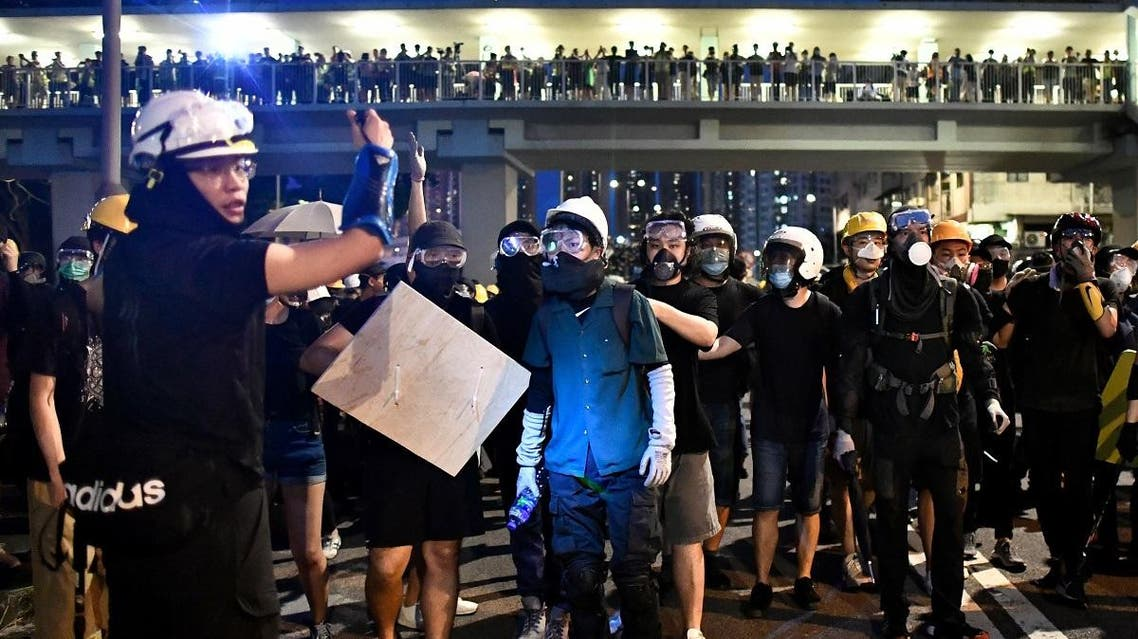 Protesters retreat as riot police move in to disperse them during a demonstration in the district of Yuen Long in Hong Kong on July 27, 2019. (AFP)