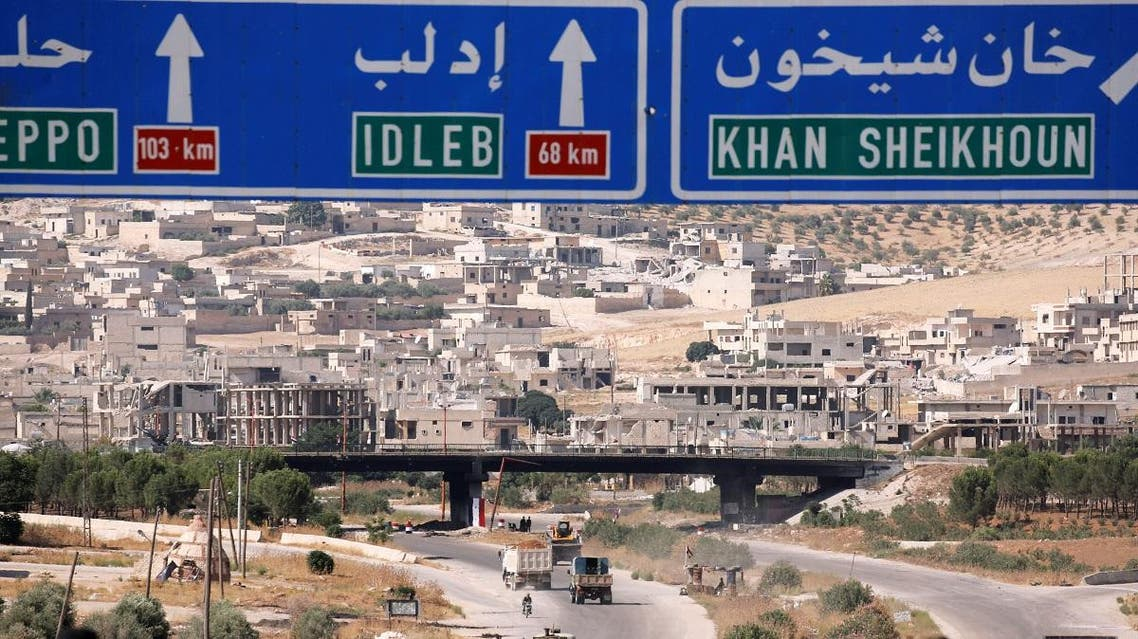 Road direction signs are pictured at the entrance enroute to Khan Sheikhoun, Idlib. (Reuters)