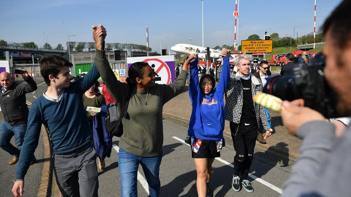 Young climate change activists leave after holding a small demonstration outside Heathrow Airport in west London. (AFP)