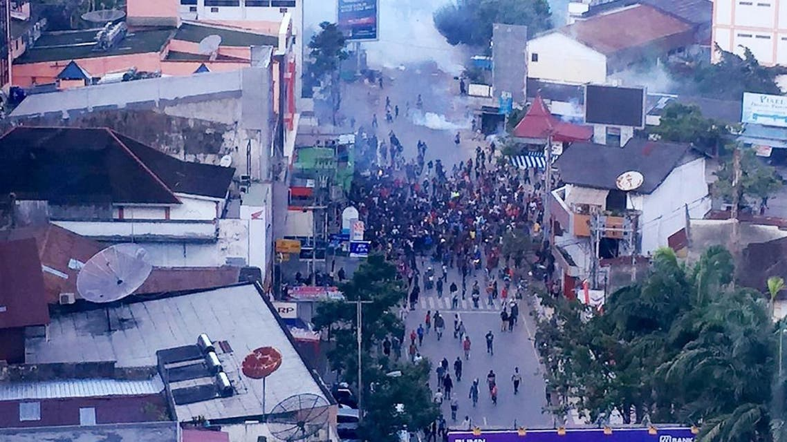 Hundreds of demonstrators marched near Papua's biggest city of Jayapura on August 29, 2019, where they set fire to a regional assembly building and hurled rocks at shops and hotels. (AFP)