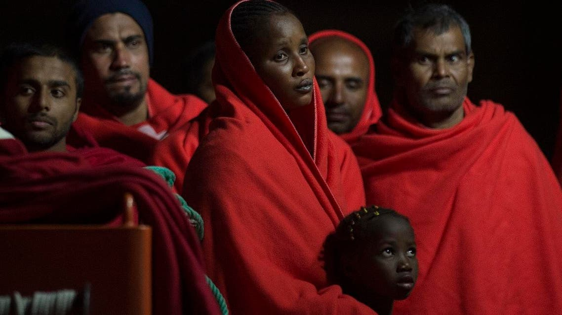 Migrants queue upon their arrival at the harbour of Malaga on August 29, 2019, after an inflatable boat carrying 132 migrants was rescued by the Spanish coast guard, off the Spanish coast. (AFP)
