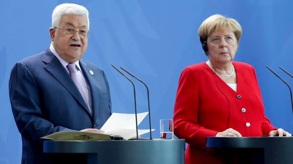 German Chancellor Angela Merkel, right, and Palestinian President Mahmoud Abbas, left, addresss the media during a joint statement prior to a meeting at the Chancellery in Berlin, Germany, Thursday, Aug. 29, 2019. (AP)