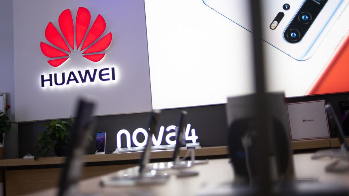 In this photo taken on May 27, 2019, a Huawei logo is displayed at a retail store in Beijing. China is digging in for a tough period of deteriorating ties with the United States, fanning the flames of patriotism with Korean War films, a viral song on the trade war, and editorials lambasting Washington.