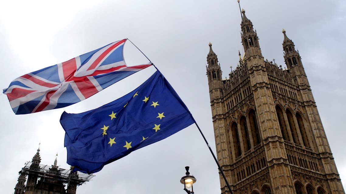 FILE PHOTO: Flags flutter outside the Houses of Parliament, ahead of a Brexit vote, in London, Britain March 13, 2019. REUTERS/Tom Jacobs/File Photo