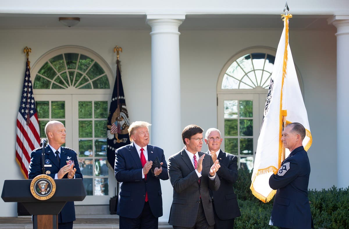 A member of the US military holds the new US Space Command flag alongside (from L) US General John W. Raymond, President Donald Trump, Secretary of Defense Mark Esper and Vice President Mike Pence during an event establishing the US Space Command in the Rose Garden of the White House in Washington, DC, on August 29, 2019. (AFP)
