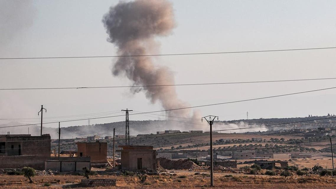 This picture taken on August 23, 2019 shows a smoke plume billowing from bombardment near the town of Maar Hitat in Syria's northern Idlib province. (AFP)