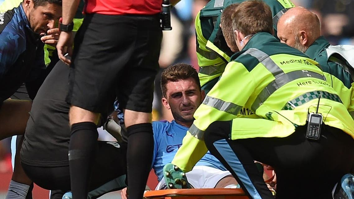 Manchester City's French defender Aymeric Laporte is taken off on a stretcher after picking up an injury, August 31, 2019. (AFP)