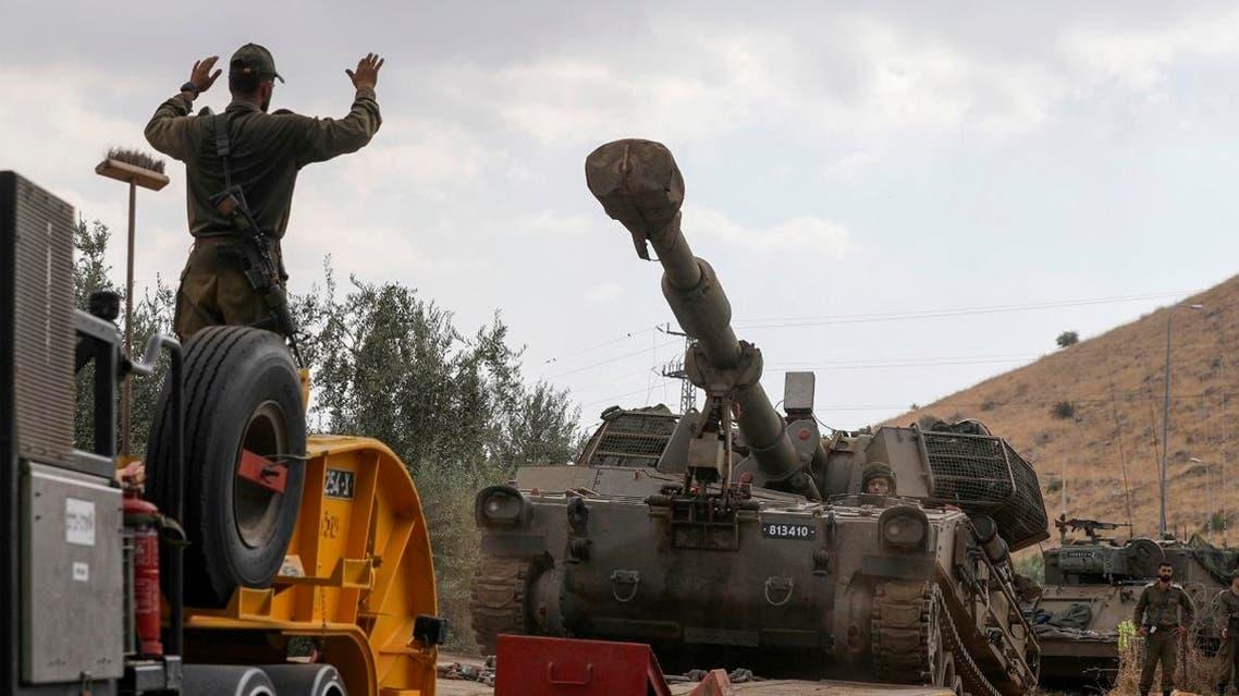 sraeli soldiers unload a self-propelled artillery gun near the Lebanese border outside the northern Israeli town of Kiryat Shemona on August 31, 2019. (AFP)