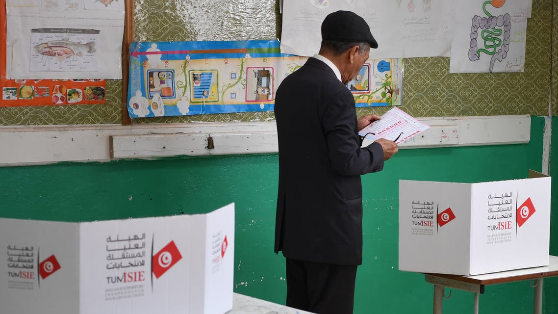 A Tunisian voter reads a list of candidates before casting his vote at a polling station in Tunis on May 6, 2018. Tunisia held its first free municipal elections Sunday as voters expressed frustration at the slow pace of change since the 2011 revolution in the cradle of the Arab Spring.