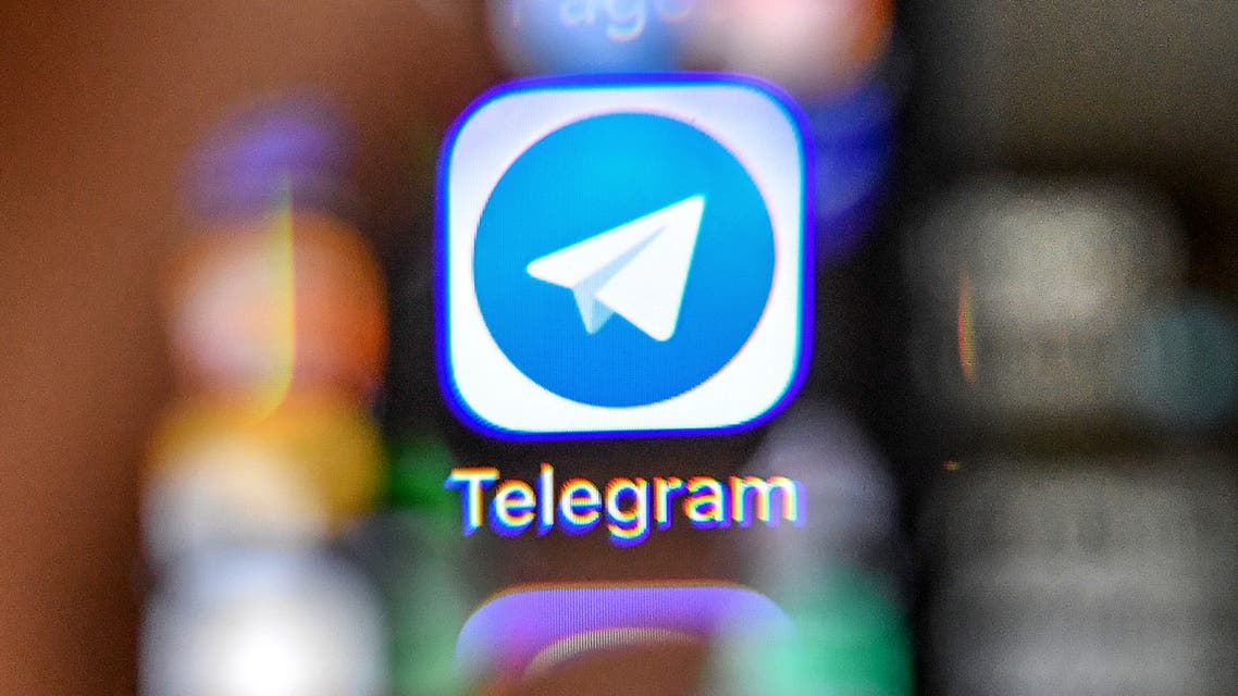 An illustration picture taken through a magnifying glass on April 17, 2018 in Moscow shows the icon of the popular messaging app Telegram on a smart phone screen. Russia's communications watchdog began today blocking access to the popular messaging app Telegram after a court banned the service for refusing to give the security services access to private conversations.