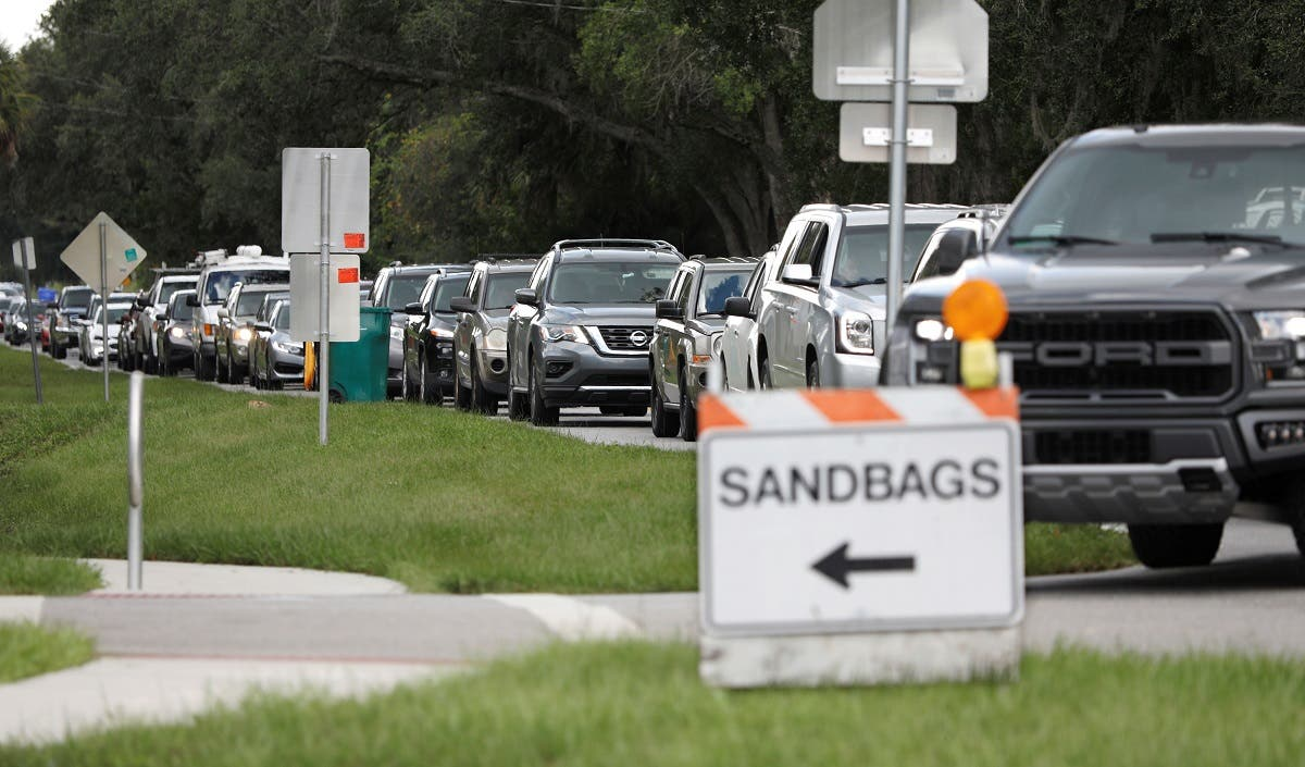 Long cars queue forms to get sandbags ahead of the arrival of Hurricane Dorian in Kissimmee. (Reuters)