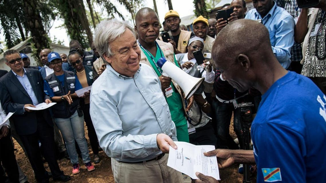 United Nation Secretary-General Antonio Guterres (L) hands a diploma to an ebola survivor during a visit to an ebola treatment centre in Mangina, North Kivu province, on September 1, 2019. (AFP)
