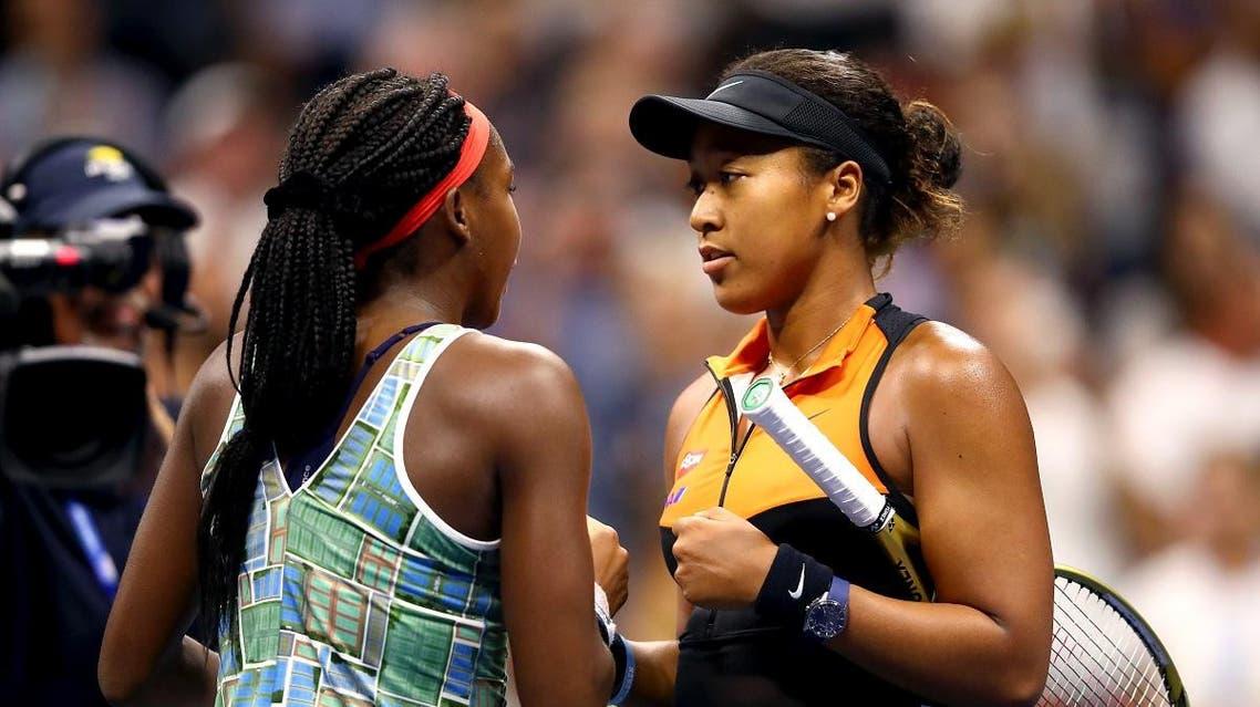 Cori Gauff of the United States and Naomi Osaka of Japan speak following their Women's Singles third round match. (AFP)