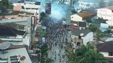 Indonesia arrests dozens for Papua protests that set buildings afire
