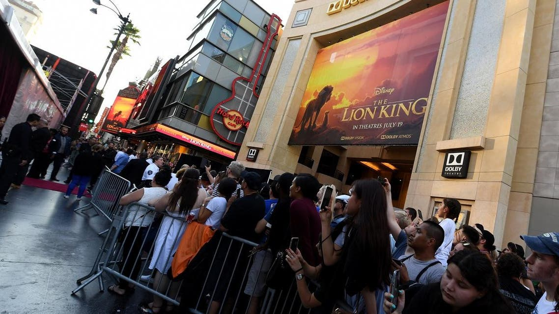 "Fans wait outside the Dolby theatre as guests arrive for the world premiere of Disney's ""The Lion King"" on July 9, 2019 in Hollywood. (AFP)"