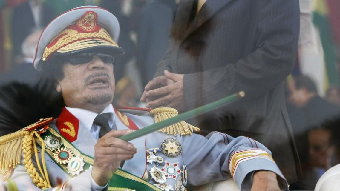 File photo of former slain Libyan leader Gaddafi gestures with a green cane as he attends a military parade in Green Square in Tripoli celebrating the 40th anniversary of the 1969 military coup. (File photo: AP)