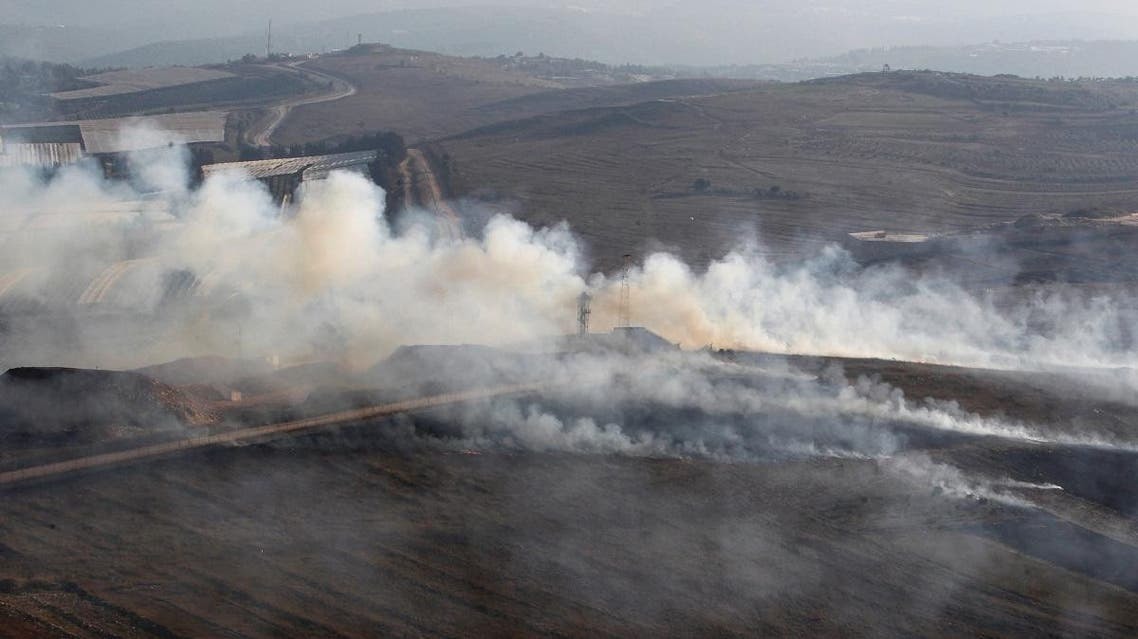 Smoke rises from shells fired from Israel in Maroun Al-Ras village, near the border with Israel, in southern Lebanon. (Reuters)