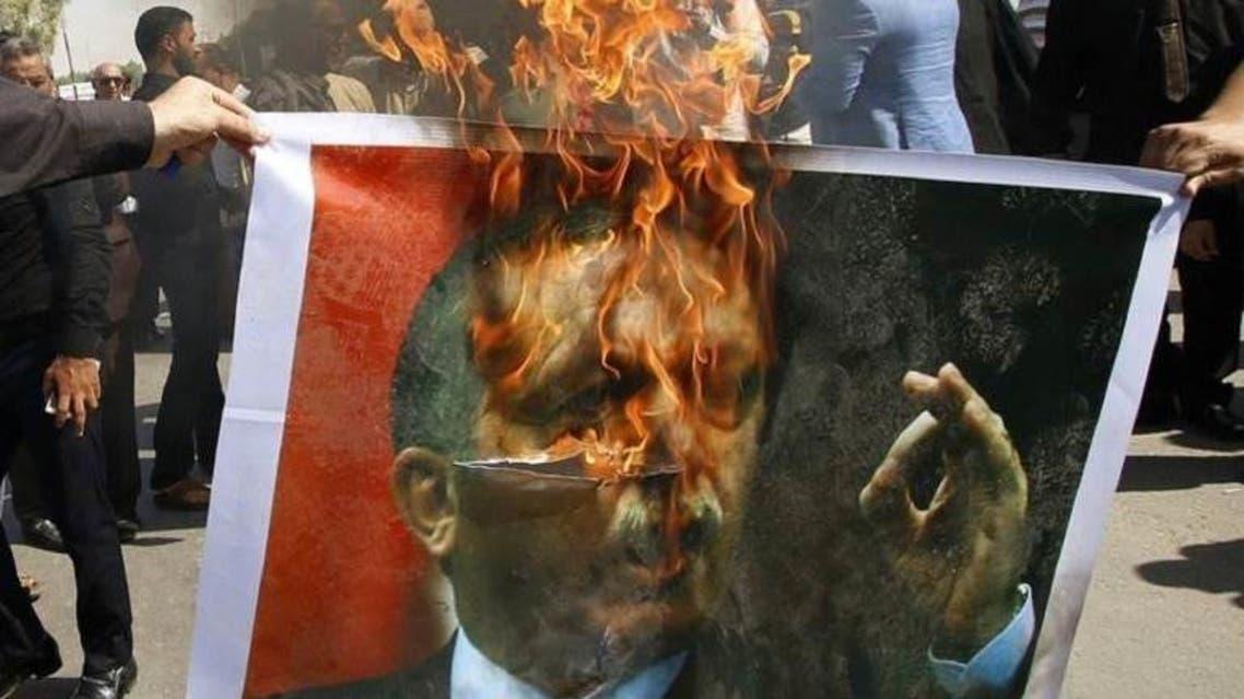 خلال تظاهرات أمام معبر باب الهوى .. احراق صورة أردوغان