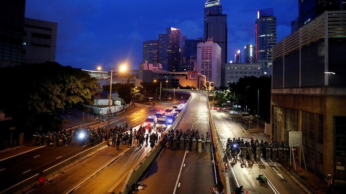 Riot police stand guard before they disperse anti-extradition bill protesters during a march in Hong Kong. (Reuters)