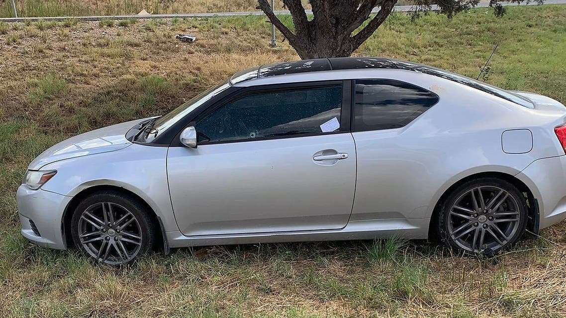 This handout images obtained courtesy of Ernst Villanueva taken on August 31, 2019 show a car with a bullet hole on the windows after a gunman open fire in the I-20 highway in between Odessa and Midland, Texas. (AFP)
