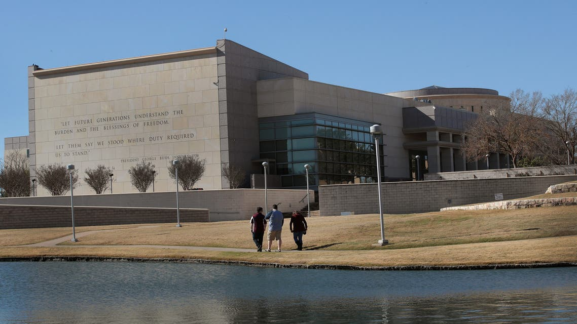 COLLEGE STATION, TX - DECEMBER 02: Visitors walk along a pond behind the George H.W. Bush Presidential Library Center on the campus of Texas A&M University on December 2, 2018 in College Station, Texas. Bush, who died on November 30, will be buried next to his wife Barbara near the library on Thursday. Scott Olson/Getty Images/AFP