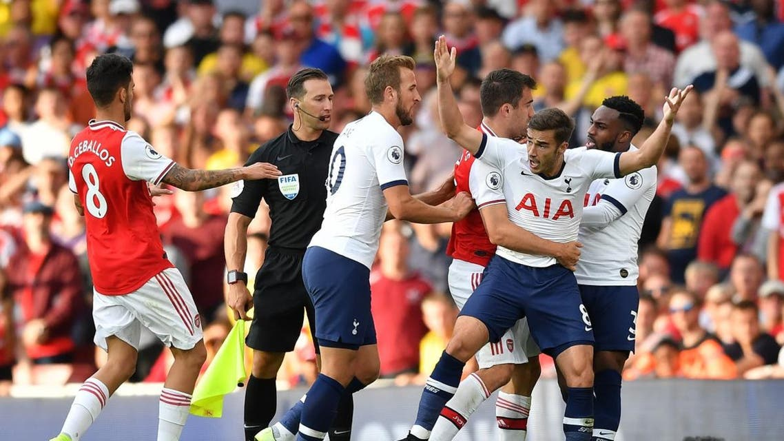 Players clash during the English Premier League football match between Arsenal and Tottenham Hotspur at the Emirates Stadium in London on September 1, 2019. (AFP)