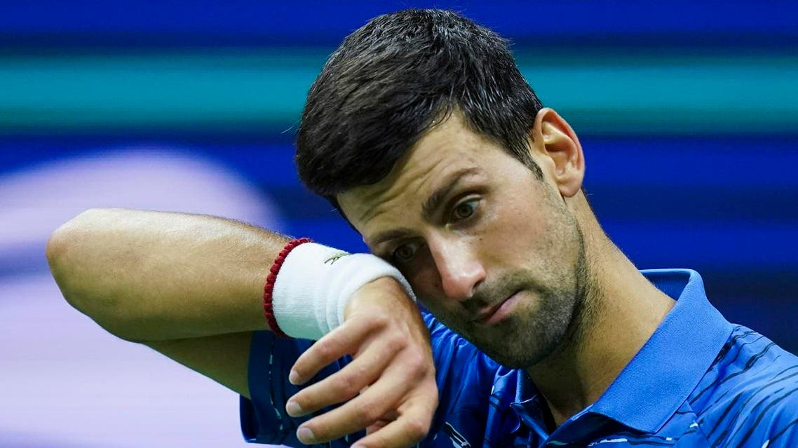 Novak Djokovic, of Serbia, reacts after losing a point against Stan Wawrinka, of Switzerland, during round four of the US Open. (AP)