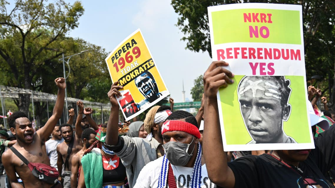 Papuan students display placards during a rally in front of the presidential palace in Jakarta on August 22, 2019, as riots and demonstrations have brought several cities in Indonesia's eastern province of Papua to a standstill this week. (AFP)