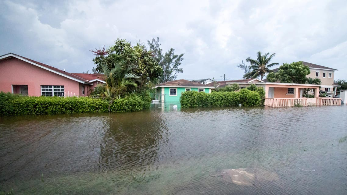 Houses line a flooded street after the effects of Hurricane Dorian arrived in Nassau, Bahamas, September 2, 2019. REUTERS