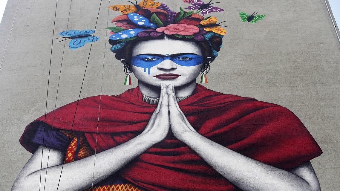 """View of Irish urban artist Fin Dac's mural """"Magdalena,"""" in honor of Mexican painter Magdalena Carmen Frida Kahlo, in the month of her birth, in Guadalajara, Jalisco state, Mexico, on July 14, 2019. (AFP)"""