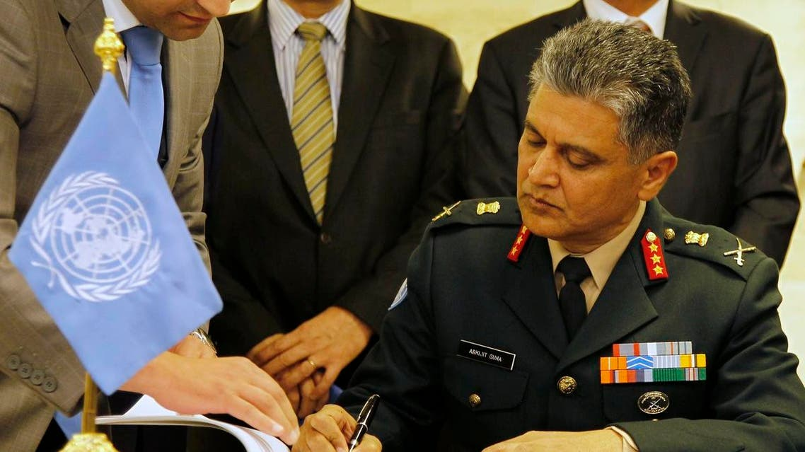 General Abhijit Guha, the Deputy Military Adviser in the U.N. Department of Peacekeeping Operations signs an agreement between Syria and the U.N. in Damascus April 19, 2012. (File photo: Reuters)
