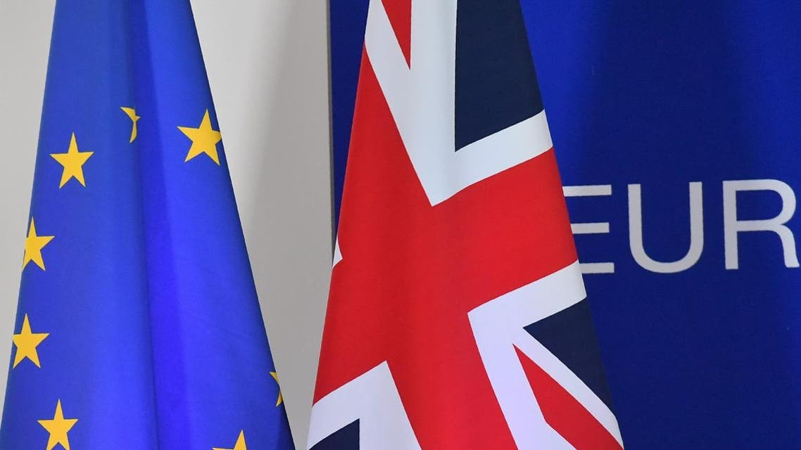 A European Union flag and a UK flag are pictured during a special meeting of the European Council to endorse the draft Brexit withdrawal agreement and to approve the draft political declaration on future EU-UK relations on November 25, 2018 in Brussels. (AFP)