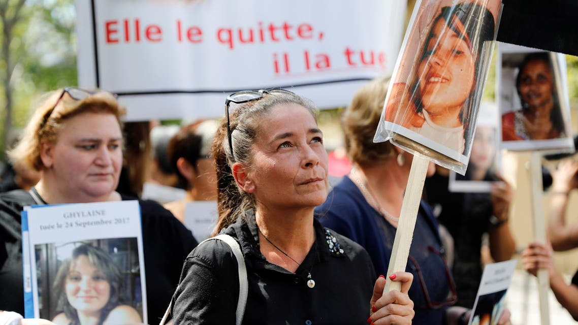 """A woman holds the picture of a victim as she takes part in a protest march with other women holding placards denouncing the violence against women and called by the French association """"Feminicides par compagnons ou ex"""" (Feminicides by companion or ex) on the opening day of the """"Grenelle on domestic violence"""", in Paris (AFP)"""