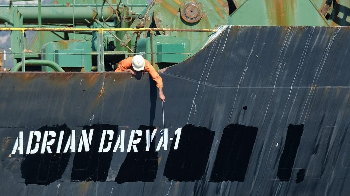 A crew member checks the new name of Iranian oil tanker Adrian Darya, formerly known as Grace 1, off the coast of Gibraltar. (File photo: Reuters)