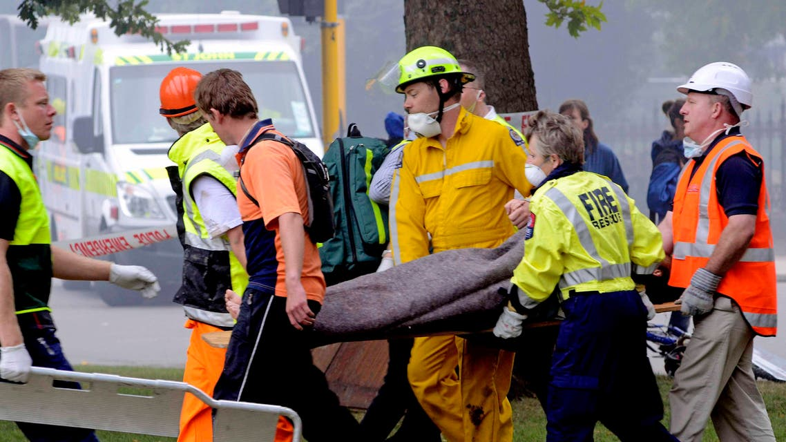 An injured person is carried by rescue workers after an earthquake rocked Christchurch, New Zealand, Tuesday, Feb. 22, 2011. (AP)