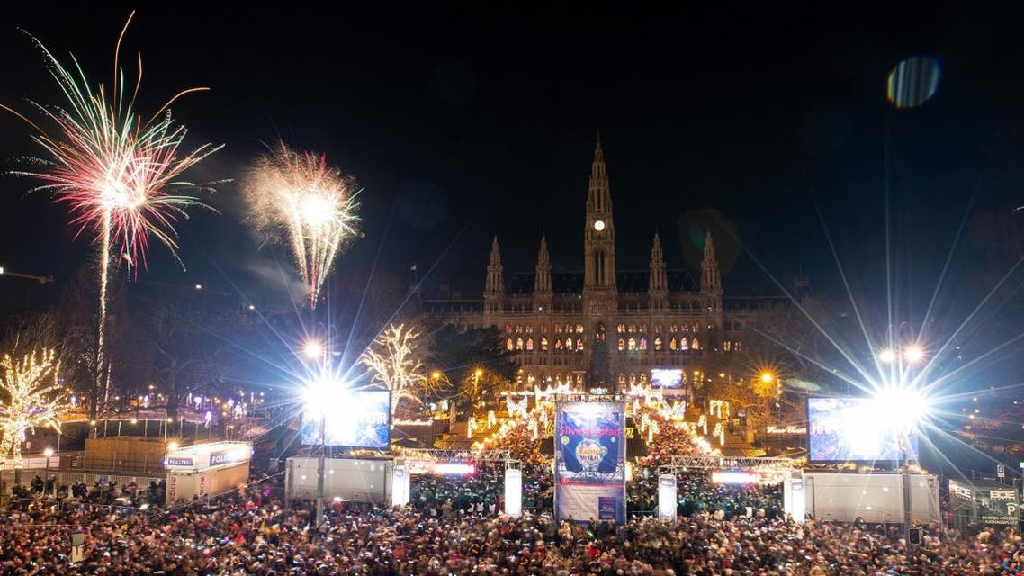 """Fireworks explode over Vienna's city hill at the """"Silvesterpfad"""" to usher in the New Year on January 1, 2019. (AFP)"""