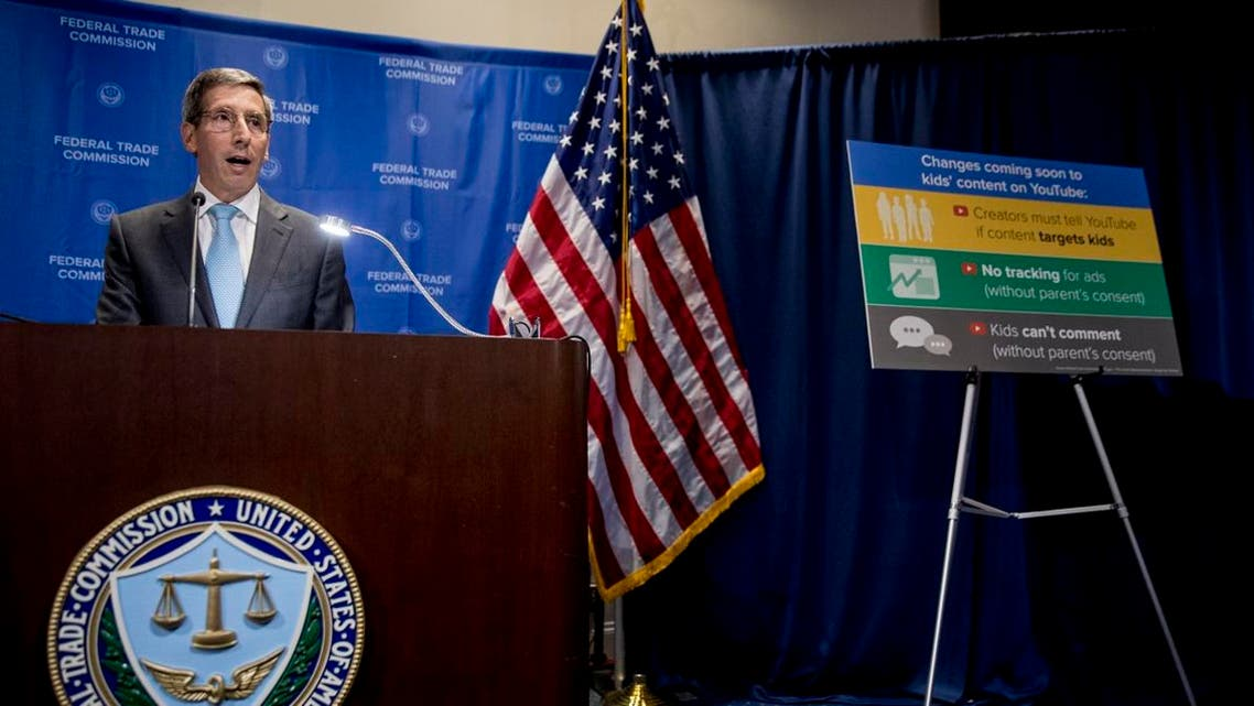 A sign with coming changes to kids' comment on YouTube is displayed as Federal Trade Commission Chairman Joe Simons speaks at a news conference at the Federal Trade Commission in Washington, Wednesday, Sept. 4, 2019, to announce that Google's video site YouTube has been fined $170 million to settle allegations it collected children's personal data without their parents' consent. (AP)